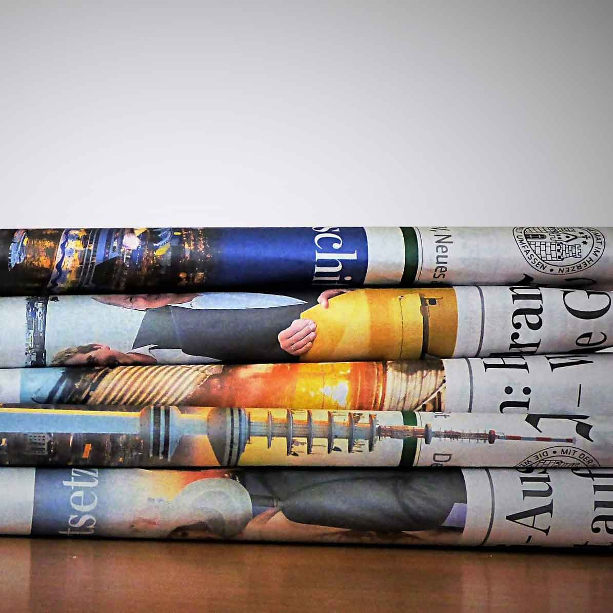 This is an image of a stack of newspapers sitting on a table