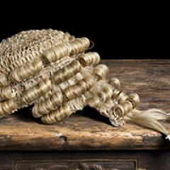 barrister wig on wooden table