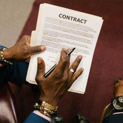 two men going over a contract