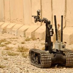 US navy robot, Talon, moves towards a mock IED