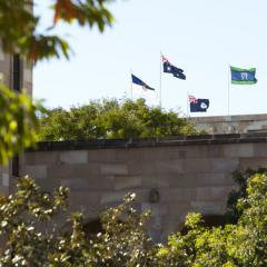 Flags on the Forgan Smith building