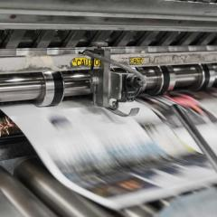 Printing press printing newspaper