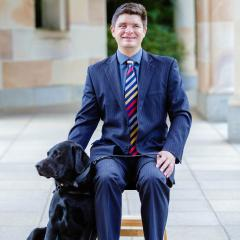 This is an image of Associate Professor Paul Harpur with his guide dog, Sean.