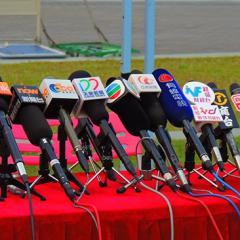 bank of journalist microphones
