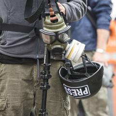 journalists with protective equipment