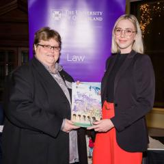 Grace Vipen accepting her law award from Terri Mottershead