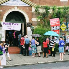 people lining up to cast their vote in an Australian election.