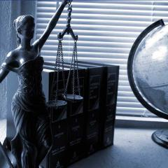 black and white lady justice with books and globe